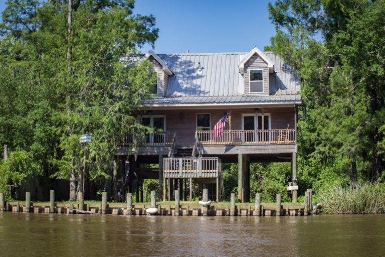 2-storey house in front of river